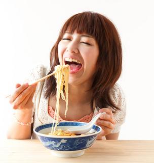 eatingnoodlesFotolia_44125301_XS.jpg